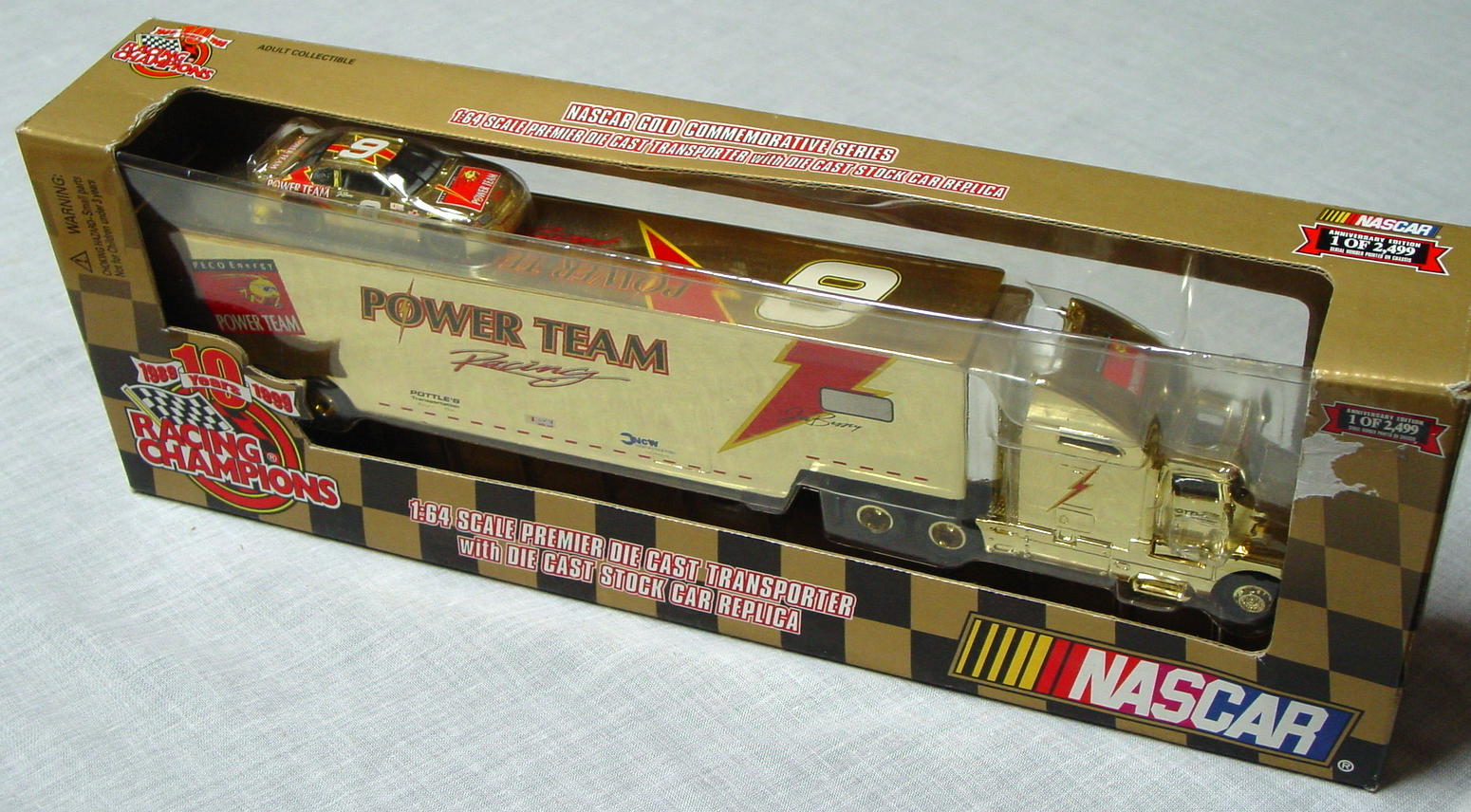 NASCAR 64 - RC Gold Transporter Power Team 6 1/2499 with car