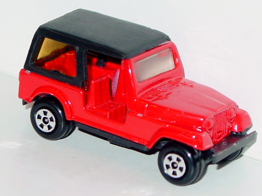 64 - ERTL REPLICA Jeep Red and black three slight chips