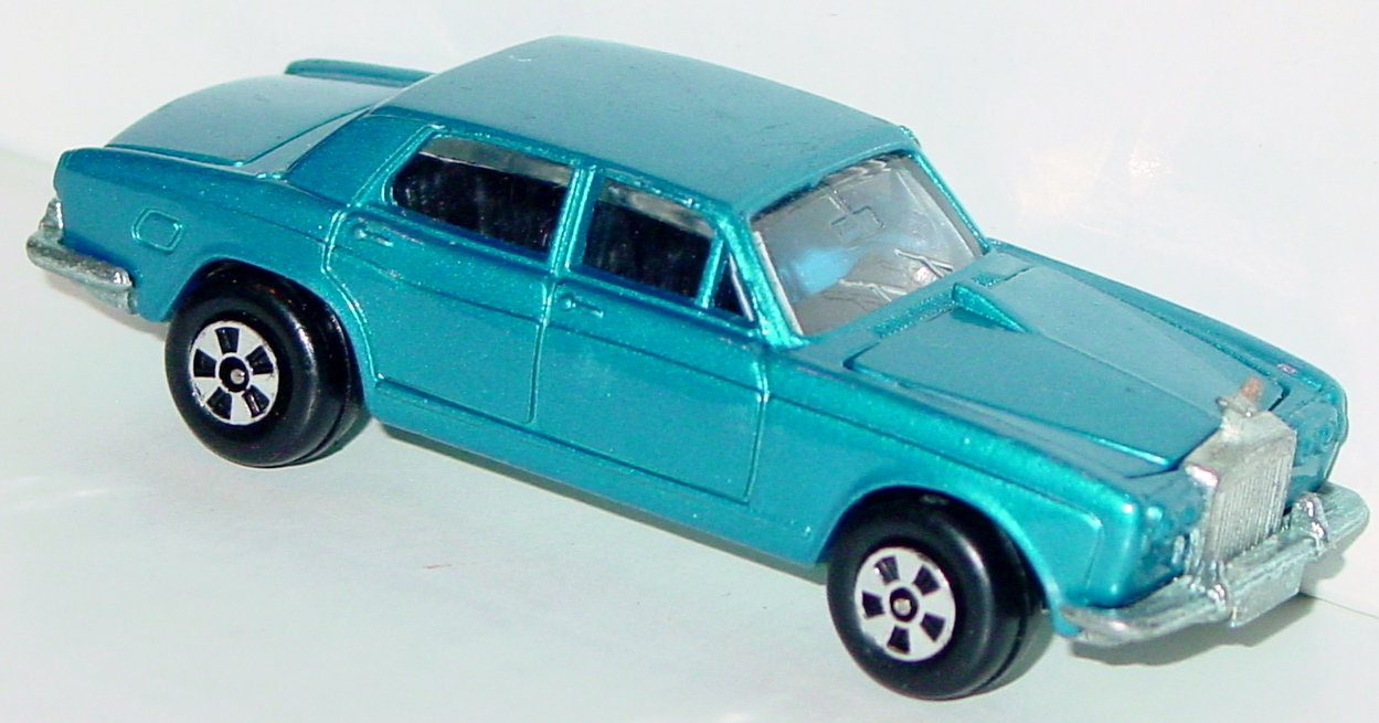 64 - ERTL REPLICA Rolls Silver Shad light Blue two slight chips met base