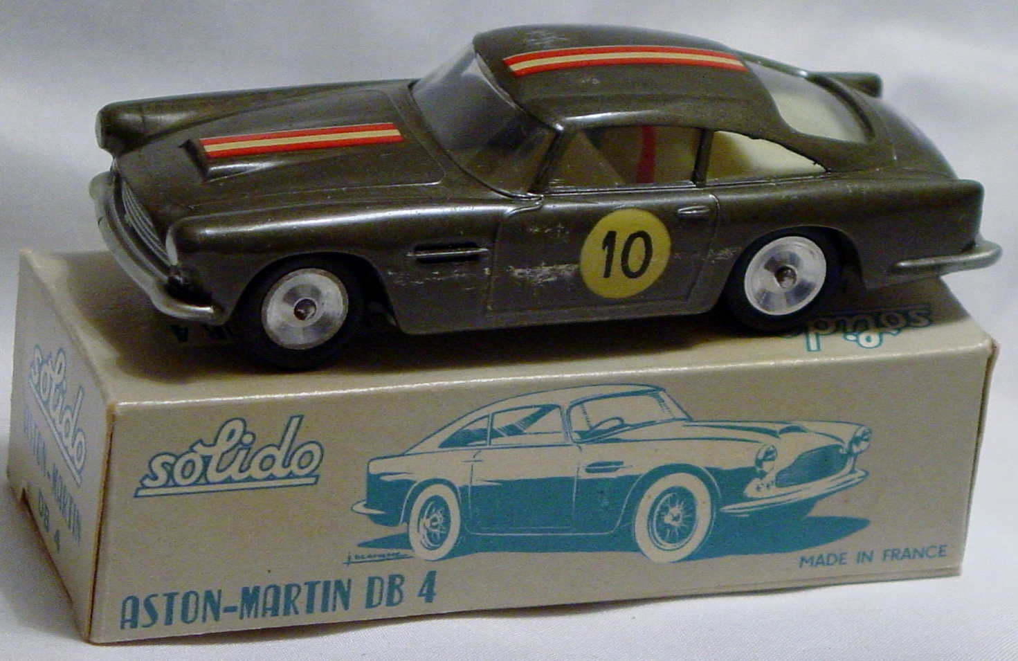 43 - SOLIDO 111 Aston DB4 Silver roof/dr smudge C9 box
