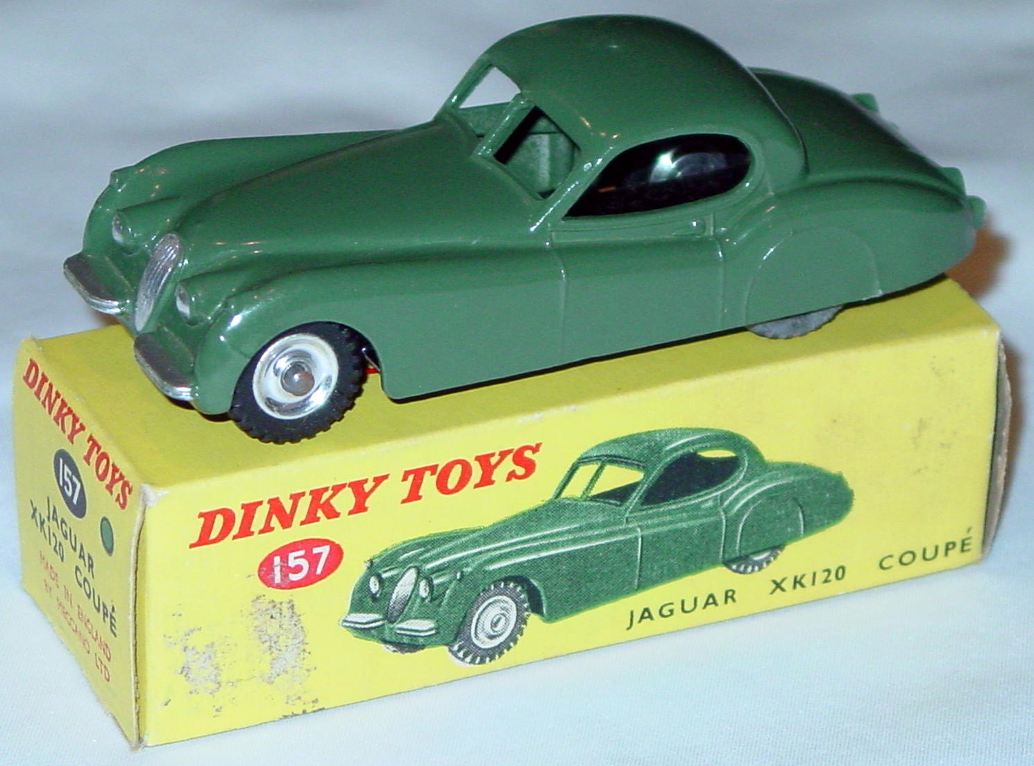 Dinky 157 - Jaguar XK120 dark Sage Green spun hubs two slight chips C9- box