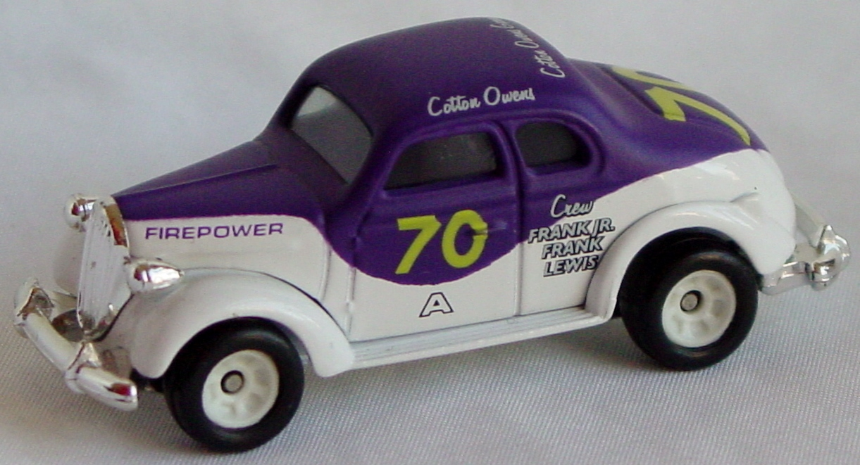 64 - ERTL 37 Plymouth Purple/White Cotton Owens