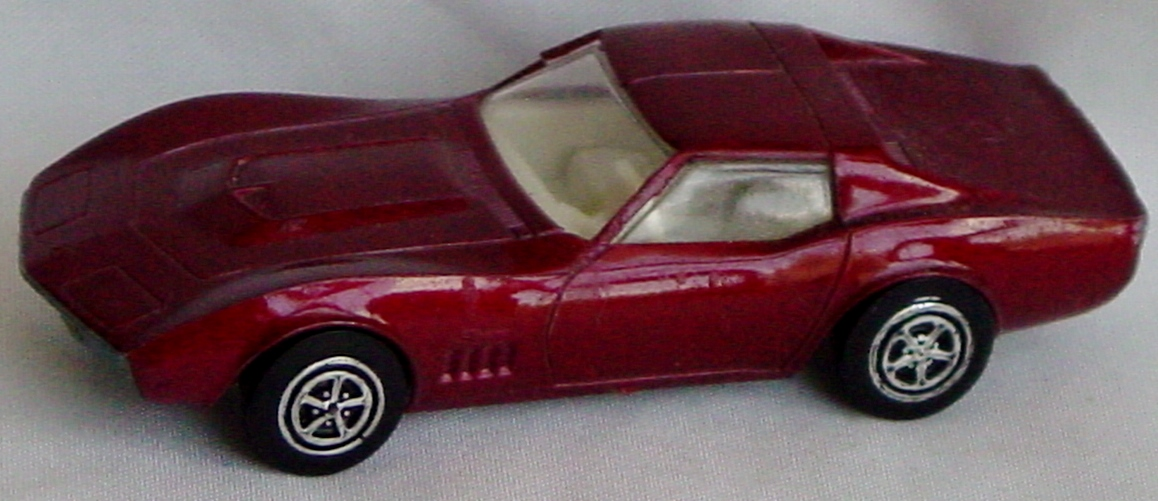 64 - KENNER Zip Strip Corvette Stingray met dark Red