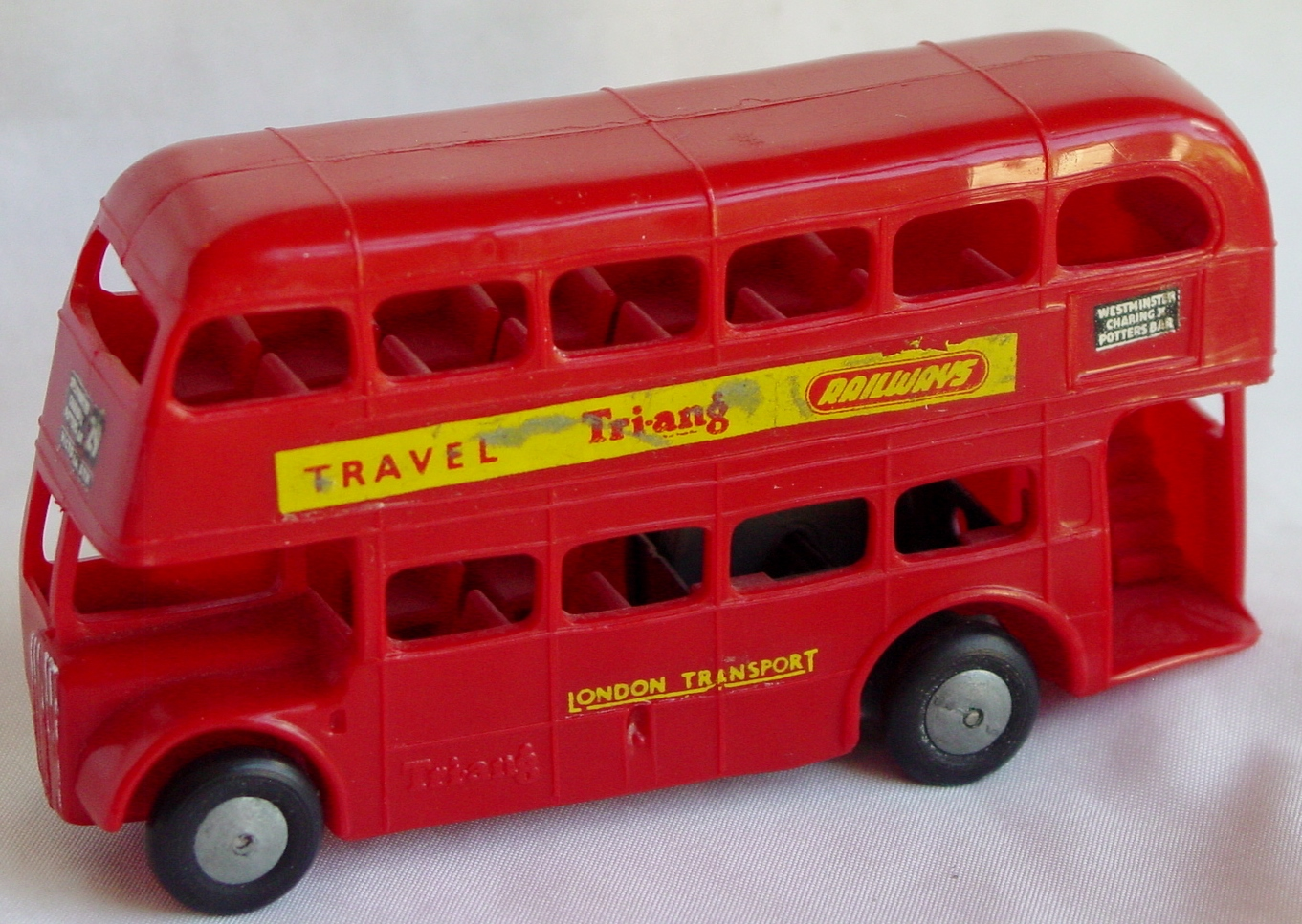 43 - TRIANG plastic friction Bus Red