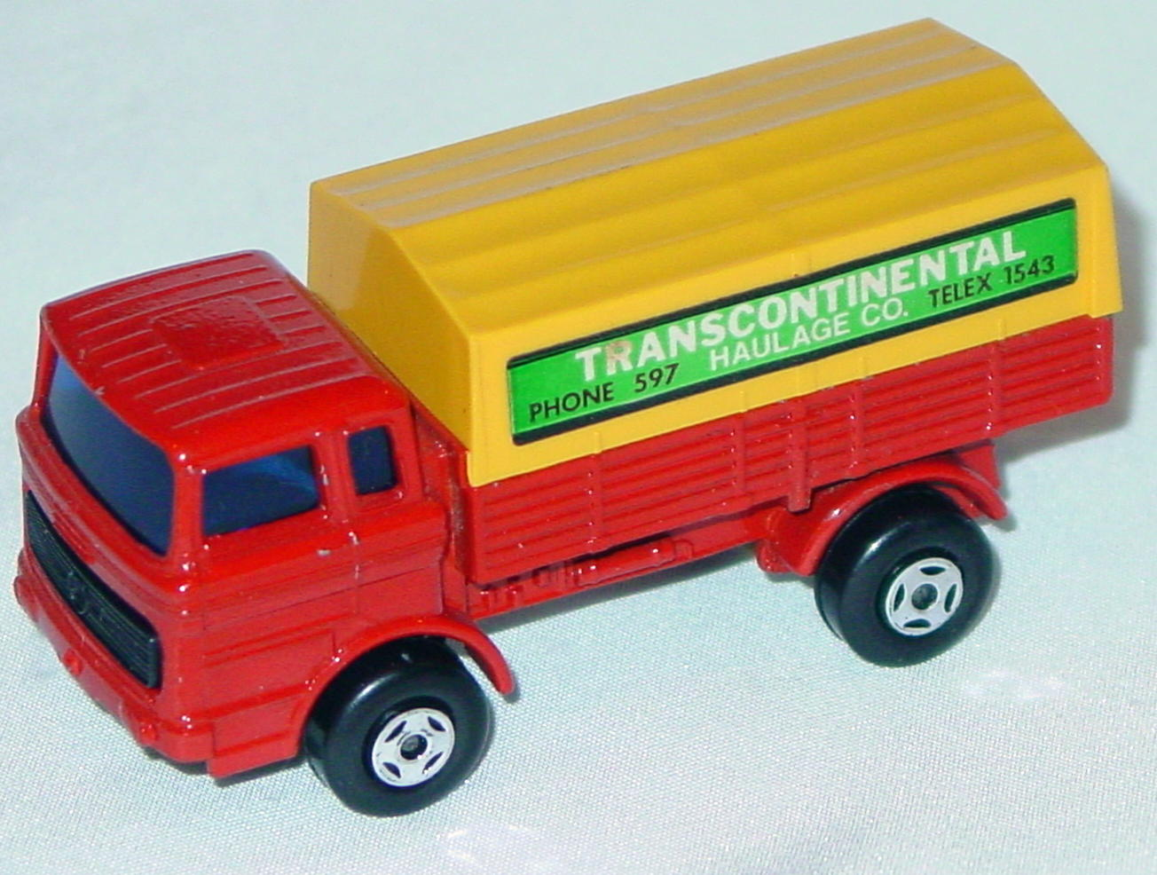 Lesney SuperFast 01 A 6 - Merc Truck Red and org-yellow Transcon with 1978 on base